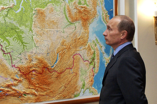 Russian President Putin stands in front of map of Russia and Commonwealth of Independent States at Novo-Ogaryovo just outside Moscow
